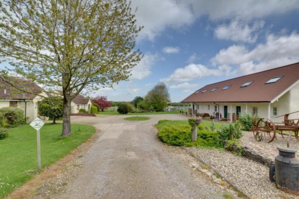 Our 4 self catering cottages set around farm yard. Straw Cottage on right.