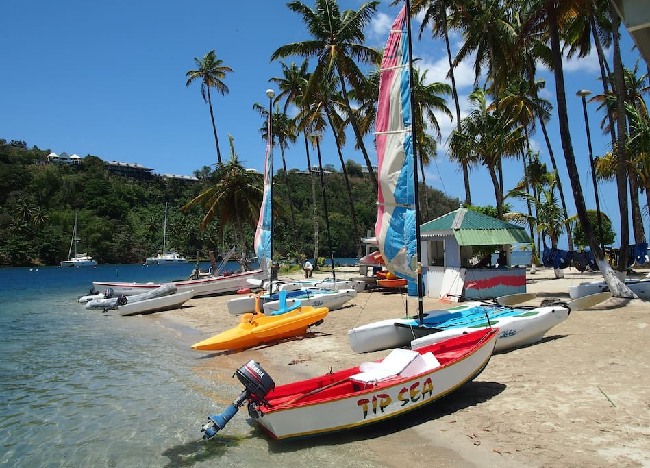 Close to a sandy beach with water sports.