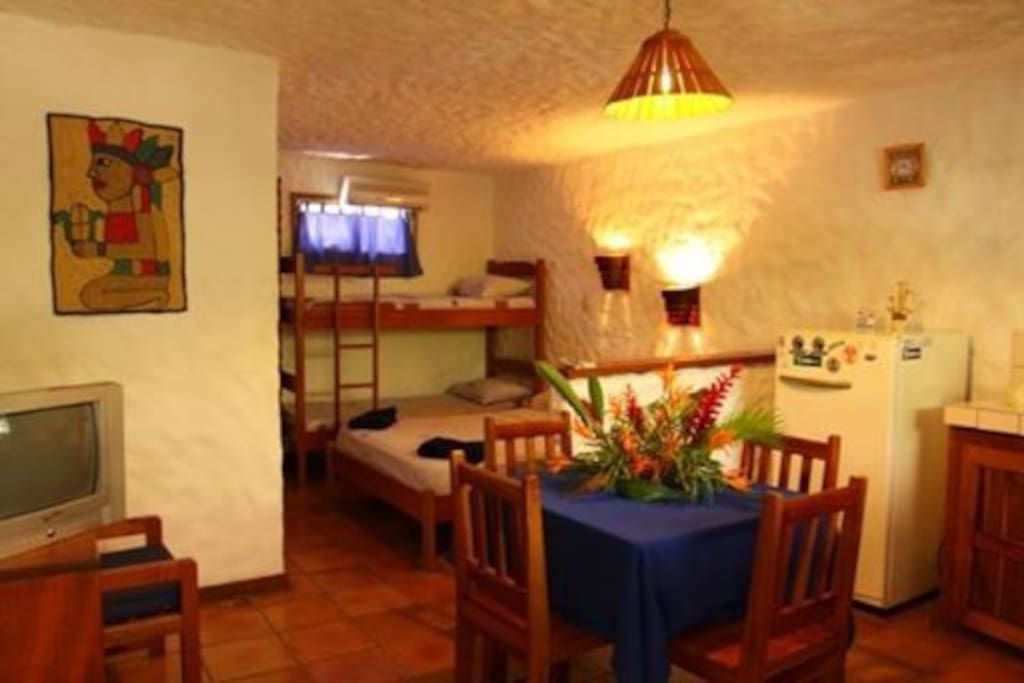 Studio: $100 per night, 4 people Max. - T.V/cable. Wifi - Dining room. - Cooks totally equipped: refrigerator, coffee maker, set complete of pots and plates and much more. - Comfortable rooms with doublebed, singlebed.  - Private Bath with hotwater