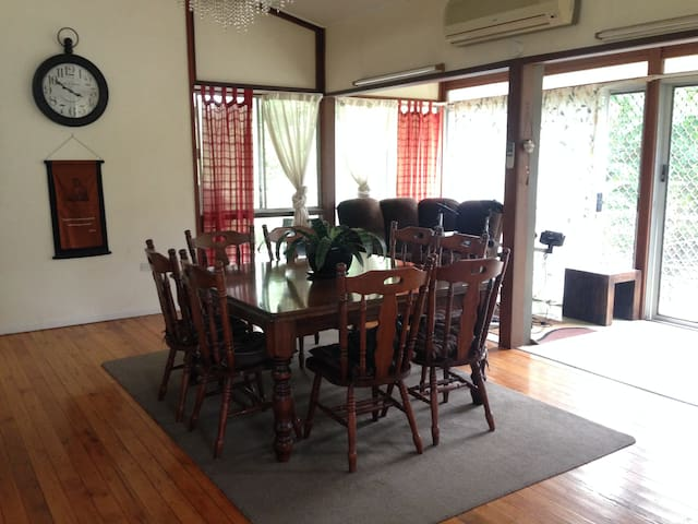 Dining area, also the access to the balcony looking out to the backyard.