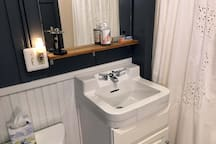 Comfortable, warm ensuite bathroom with shower, tub & wainscoting.  Amenities include extra towels, shampoo, conditioner & toothpaste.