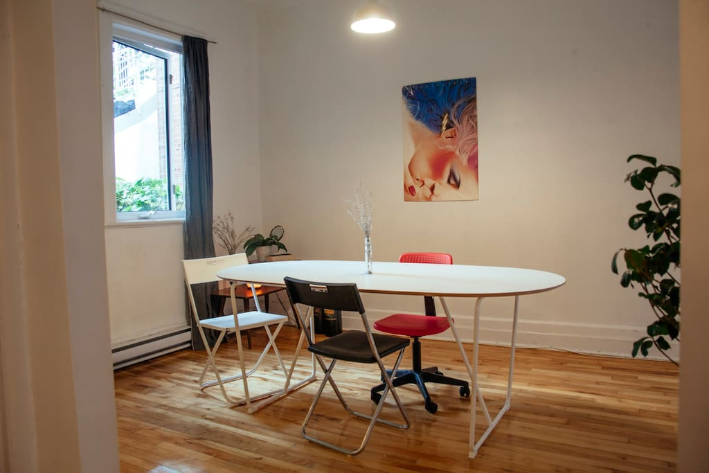 brightly lit dining area/workspace