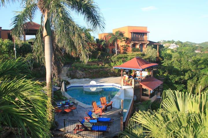 Your infinity pool, gazebo lounge area and massage spa