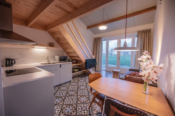 Privé Vakantiehuisje op boerderij Huize Blokland