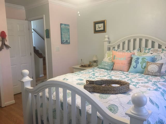 What's your mermaid name? Find out in the Mermaid Room!  Queen size bed featured in our mermaid themed bedroom. Hulu and Netflix included. Microwave and Refrigerator