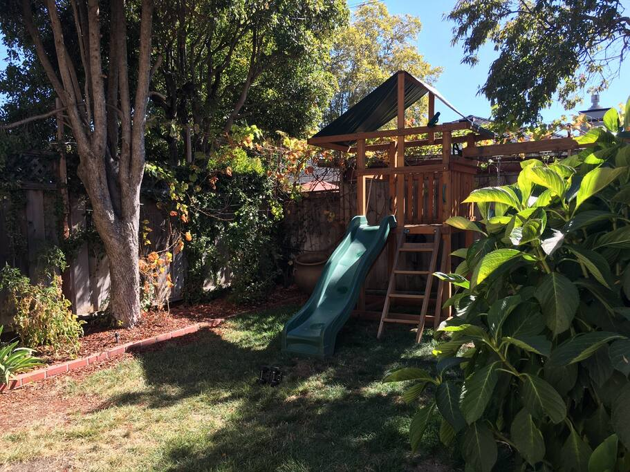 Playstructure in enclosed back yard on a sunny California day