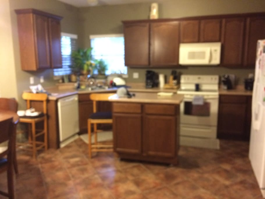 Full kitchen with dishwasher, microwave/range and water view