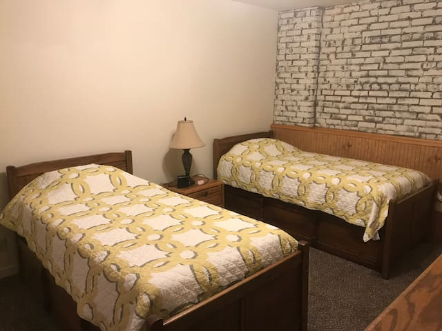 2 twin beds with 4 drawer dresser , walk in closet and alarm clock