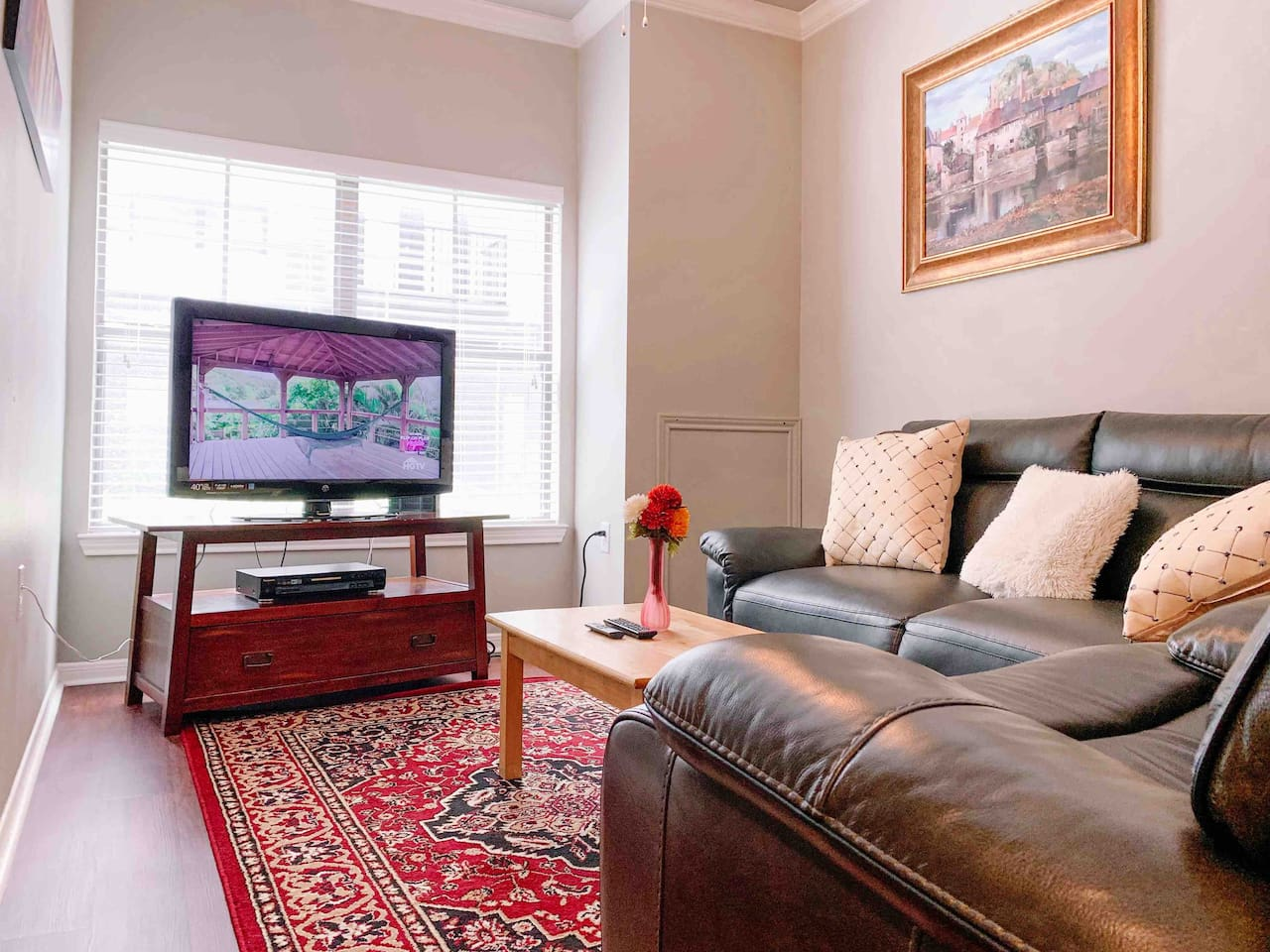 Living Room - Newly renovated & very spacious - Includes TV with Netflix, AmazonTV, live TV available through Sling TV App. New full-size comfy leather couch, sofa chair, & high speed 50mbps Wifi.