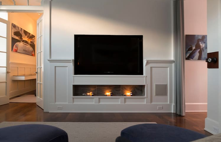 """60"""" flat screen TV/cable.   Candle place with fireless candles throughout suite"""