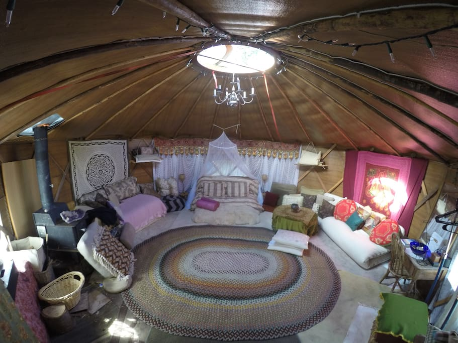 21ft Yurt, looking at one of the beds  - the yurt has 3 openable Windows and a roof circular window