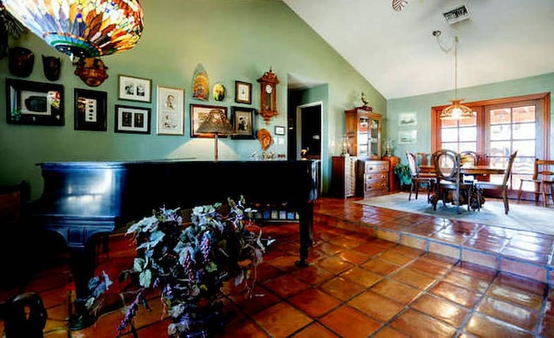 Living room, music, and dining room