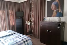 Master bedroom with balcony close to the airport