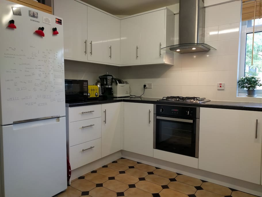 Fully fitted east-facing kitchen with kettle, coffee machine, microwave, fridge/freezer and washing machine.