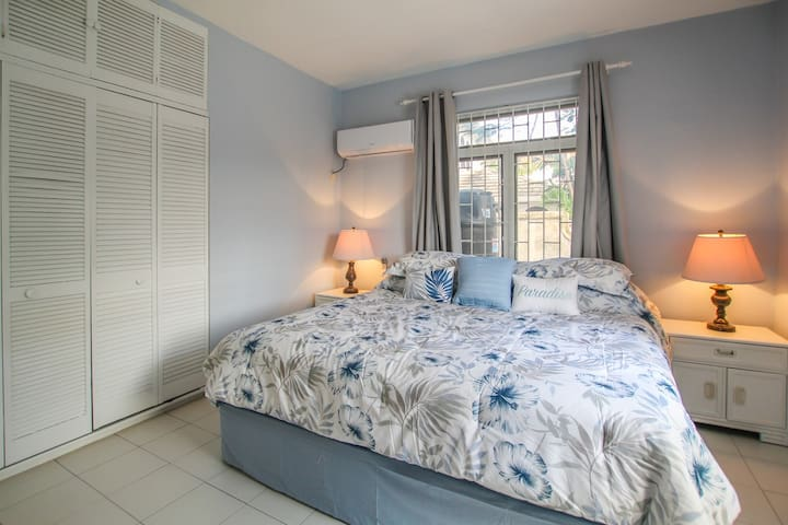 The third bedroom with a king size bed, air-conditioning and en suite