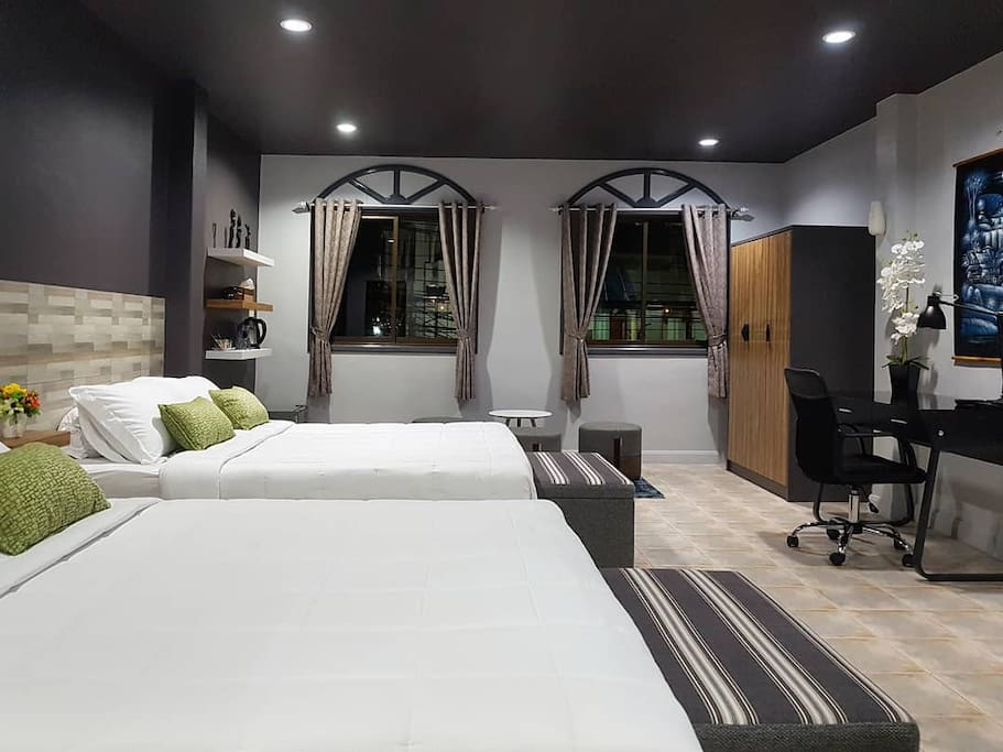 Welcome to our Family Suite with 2 king sized beds, desk/chair, Smart LED TV, free wifi, large wardrobe, latex bed/pillows for extra comfort, sitting area with views of temple, safety box, beach umbrella, quality curtains, laundry bag/service, extra foldout bed available & more greatness for you.