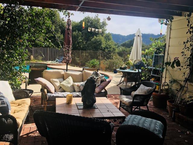 Studio  on lush patio moutain views