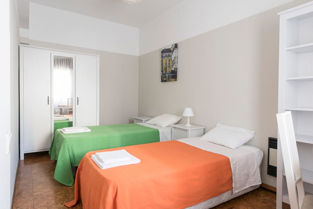 ORANGE room - 2 single beds, place to work, windows to patio, natural light all day