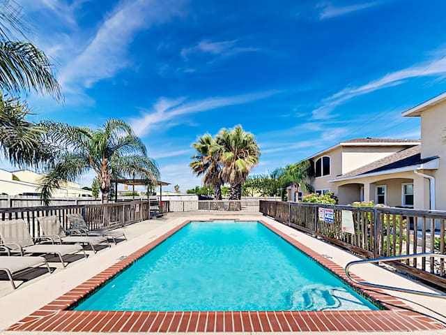 Guests have shared access to a sparkling pool, located just steps away.