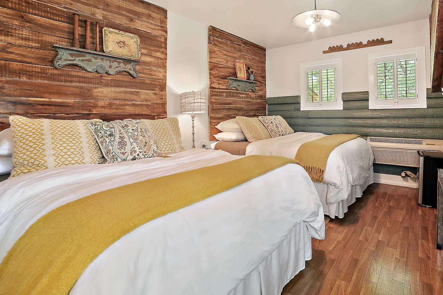 Cheery and bright custom decorated bedroom with 2 queen beds and view of Cypress Creek.