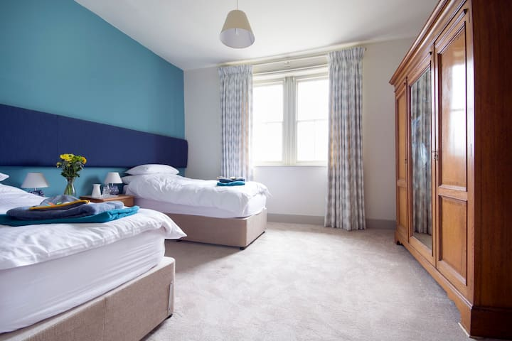 Bedroom 4  (shares a bathroom with room number 3)- can take a Super king AND 2 single beds or be set up as 4 singles