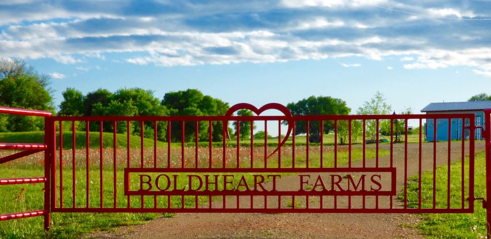 You will know you have arrived at the right place when you see the Red Fence.... Take a deep breath, that will be the roses you are smelling and fresh country air.