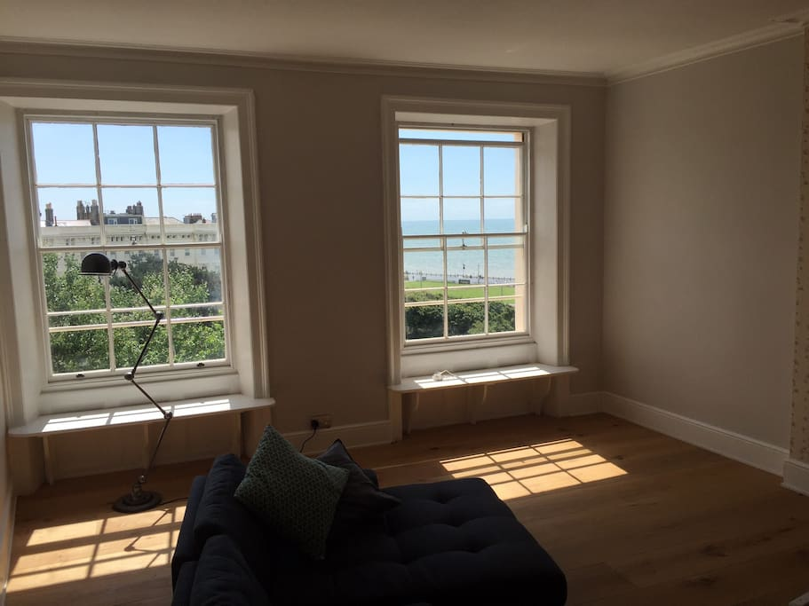 Living Room with window seats to enjoy the amazing sea views
