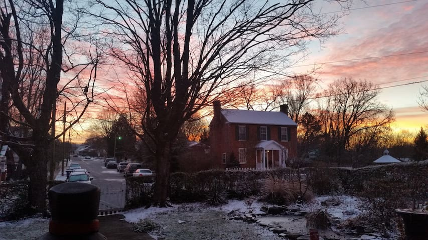 Early morning winter sunrise view from my home!  The charming house across the street was built in the 1800's and reputed stop of George Washington.