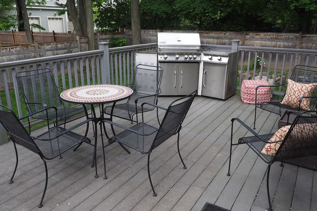 Back Deck, Grill, Dining and Seating.  Fenced in yard for privacy.