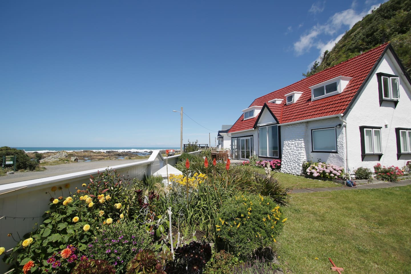 At the seaside with a blooming summer garden