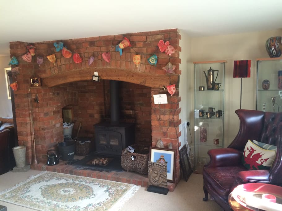 Inglenook Fire Place and cozy wood burner