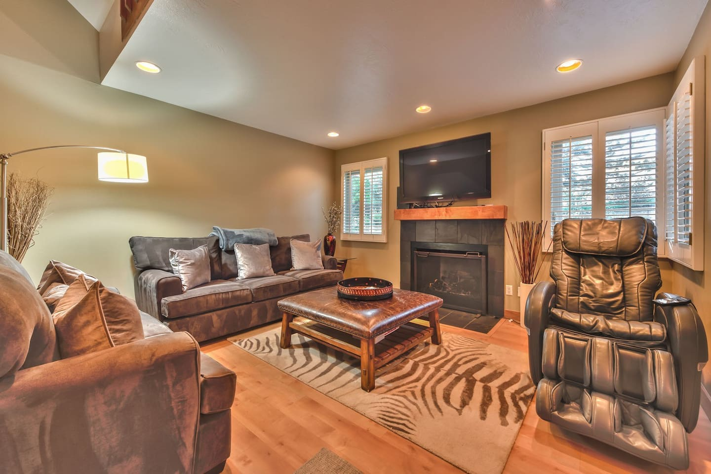 """Living Room with Comfortable Furnishings, a Massage Chair, a Gas Fireplace and a 50"""" Samsung TV"""