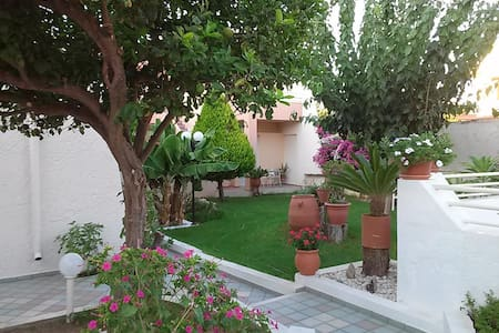 Cozy Garden View Apartment 600m from Sandy Beach