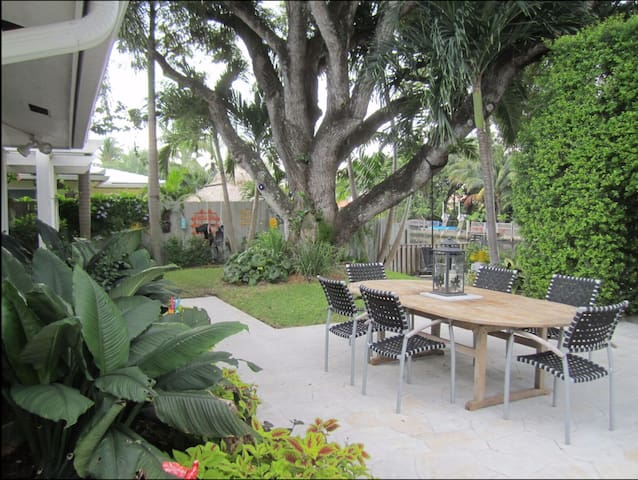 Entertainers dream with outdoor dining and granite bar for serving from kitchen. Always a blend of sun and shade in the backyard