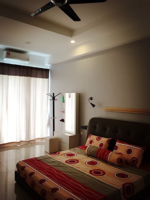 Master bedroom with attached bathroom. King size bed, Aircon, ceiling fan, mirror, hair dryer.