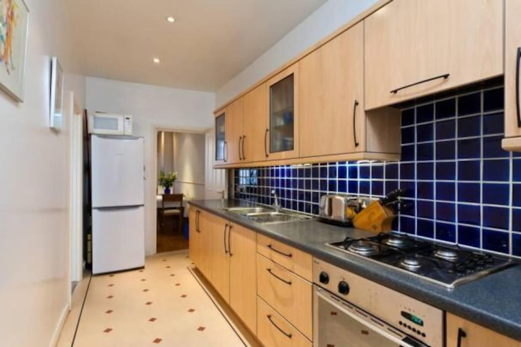 Large galley style kitchen with plenty of storage and space to cook