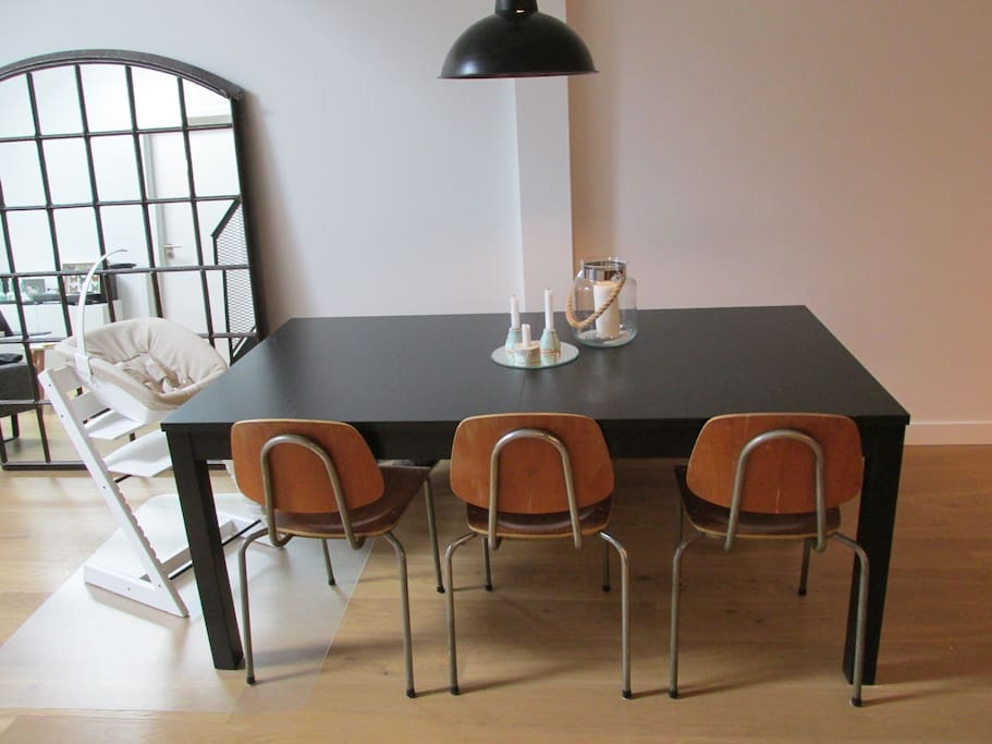 Expandable dining table, extra chairs available. Dinner party friendly!