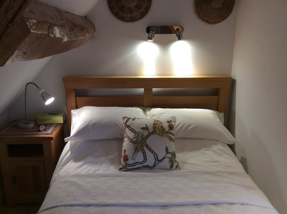 Comfortable double bed with reading lights