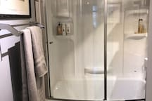 Shower and bath tub. Stocked with shampoo, conditioner and bodywash. Blow dryer and other toiletries available under sink.