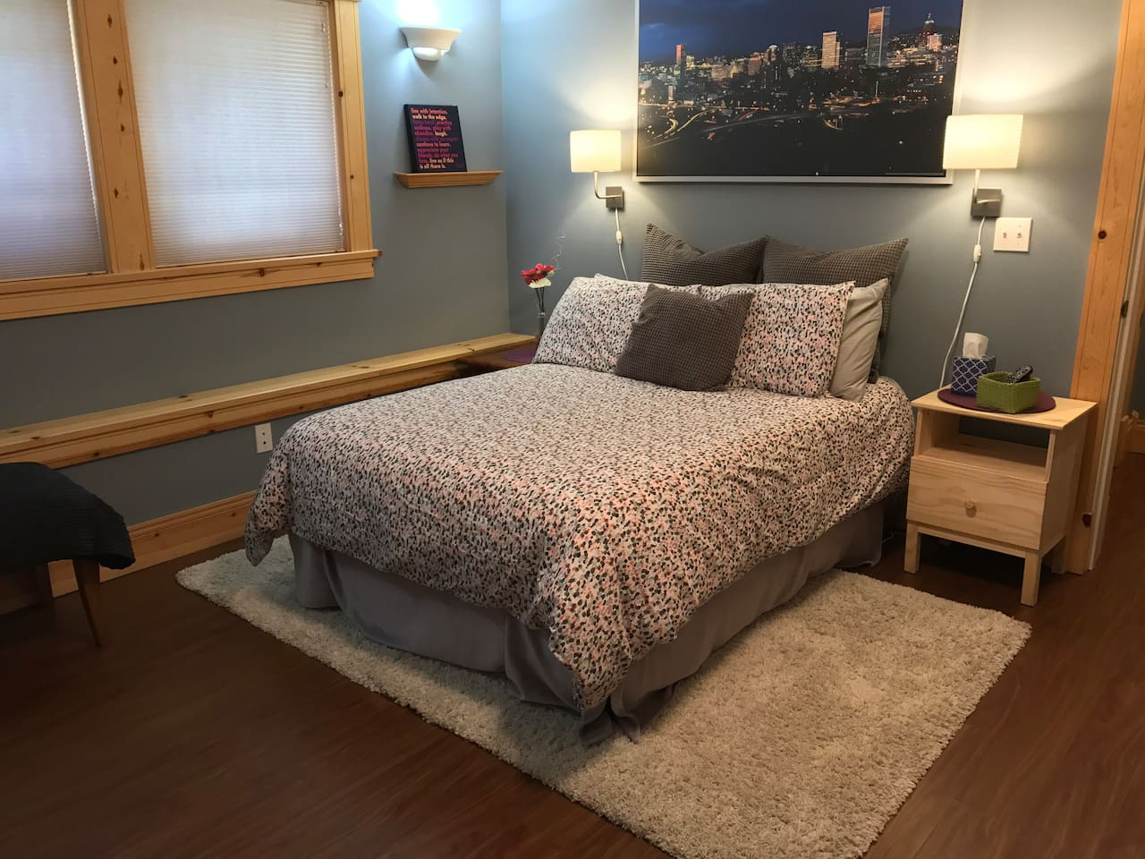 Comfy, new queen bed to rest and get ready to explore the city.