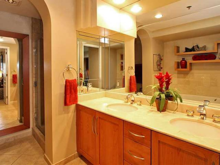 bathroom with shower and jetcuzzi tub.