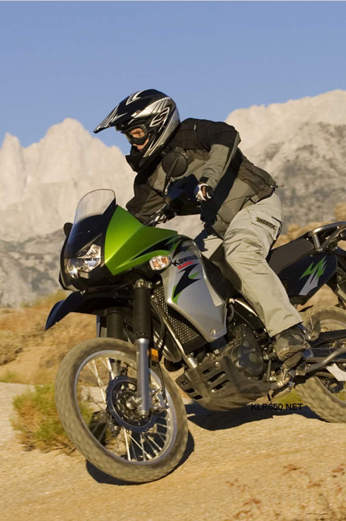 Man on motorcycle in desert