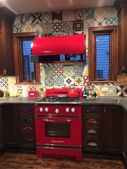 Kitchen focal point, with new retro range and hood for cooking up a storm.