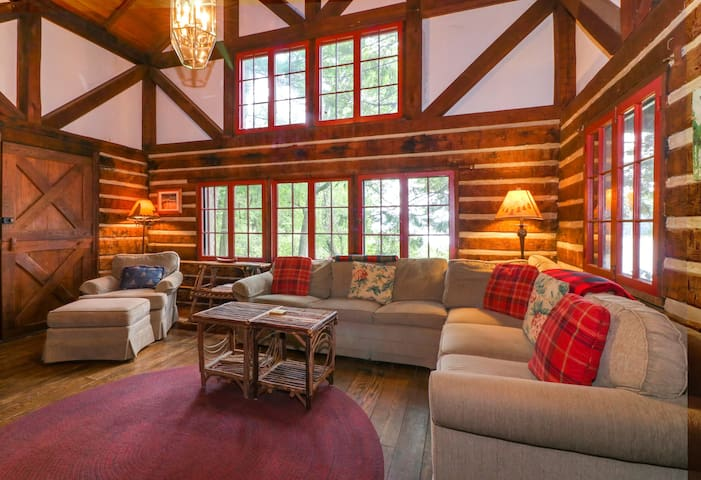 Dog-friendly, lakefront log home on a quiet cove - front deck & shared dock