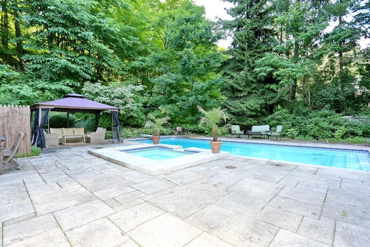Beautiful pool & hot tub with covered seating area -- Grill available for BBQ's  Pool and hot tub are available May through September.