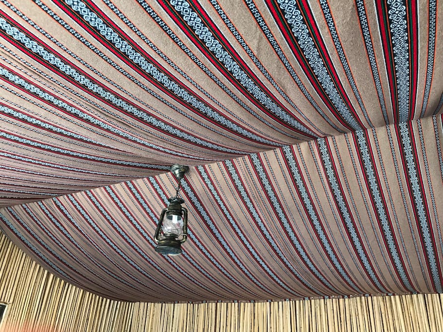Under a traditional bedouin-style canopy