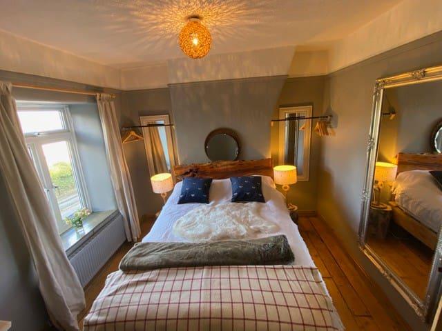 Master Bedroom - log bed and tree stump bedside tables!