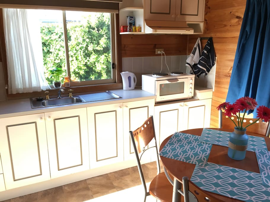 Mini oven, two stove tops, microwave, kettle and bar fridge. Cutlery and utensils provided.