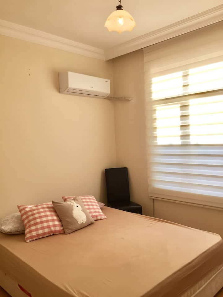 Simple room with double bed++air conditioner