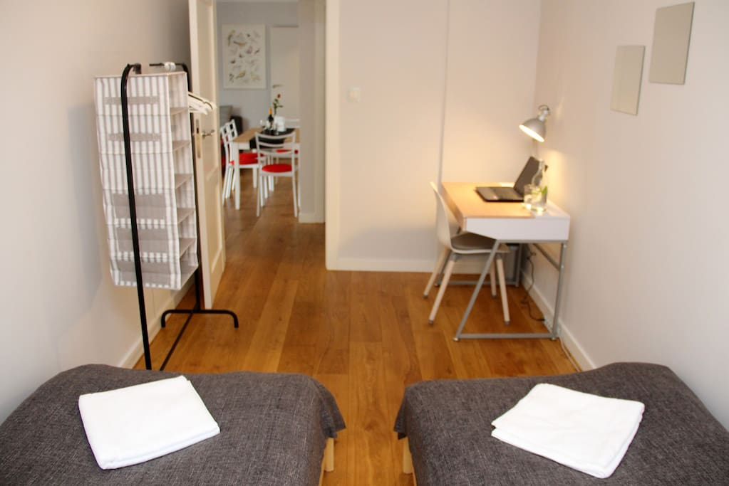 ... one BEDROOM with 2x SINGLE beds. In each bedroom you will also find a HANGER for your clothes and a small DESK.